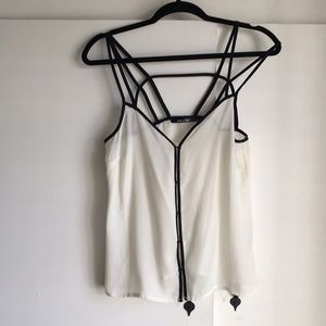 Tops - Creamy camisol with black accent